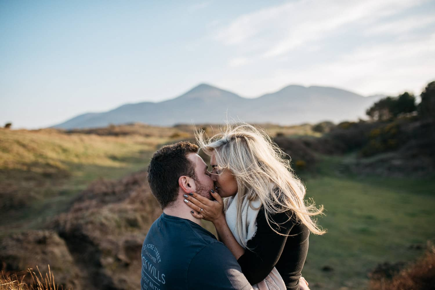 couple kissing in front of mountains Engagement Photography Northern Ireland