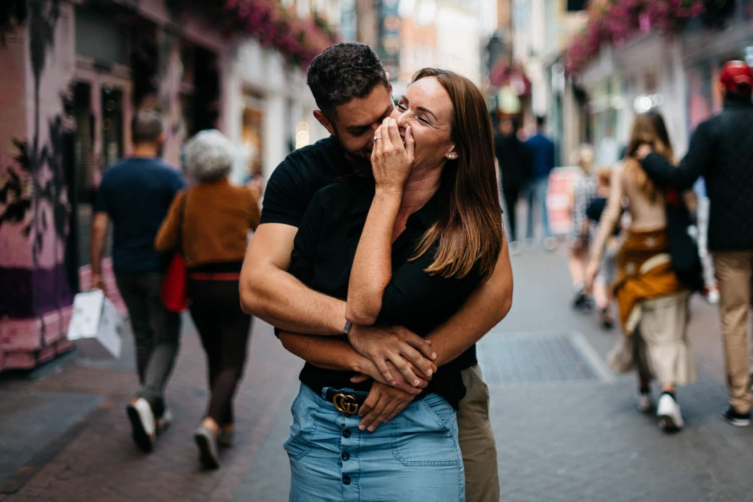couple hugging and laughing Engagement Photography Soho London