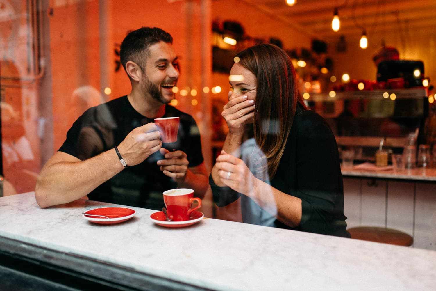 couple laughing having coffee Engagement Photos London Soho
