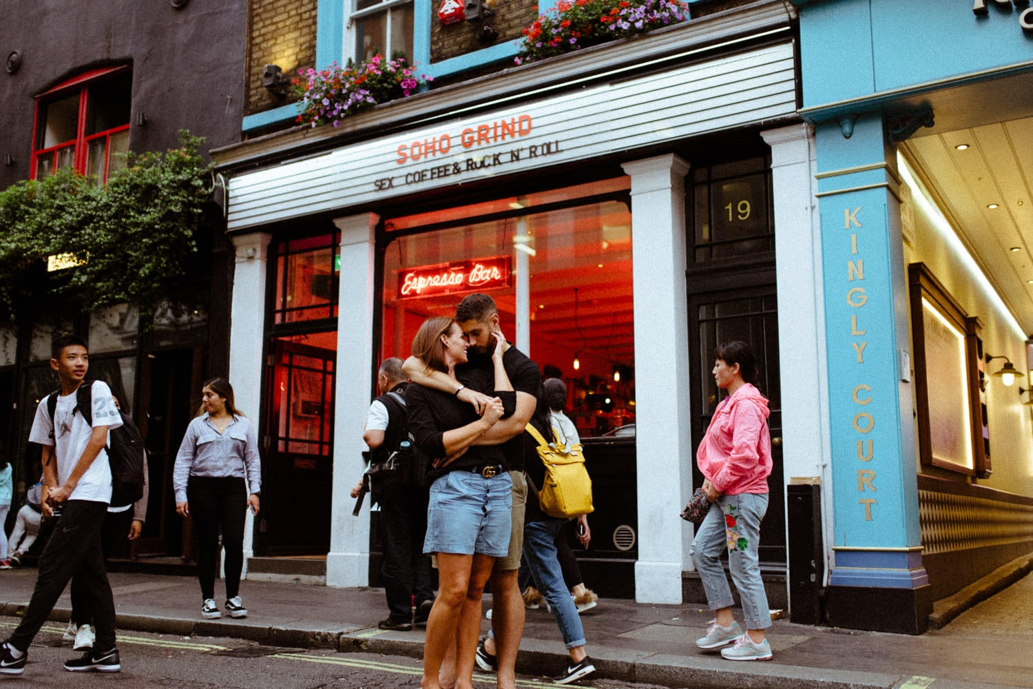 couple hugging outside soho grind Engagement Photography Soho London