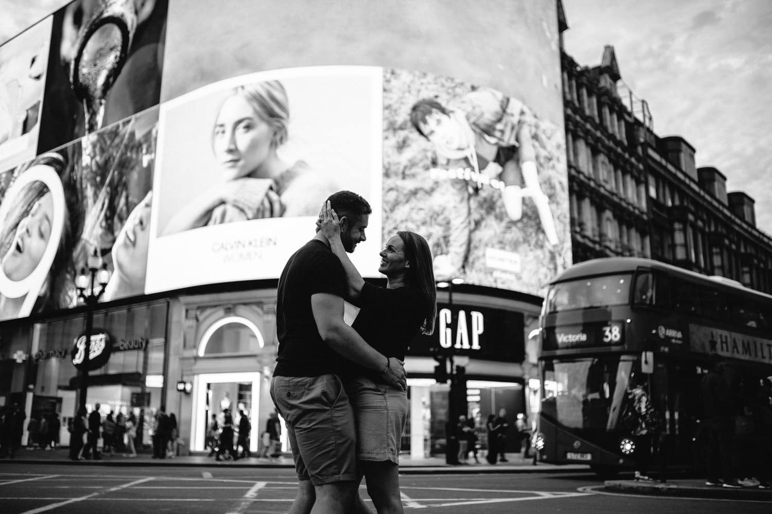 couple looking at each other Engagement Photos Soho London