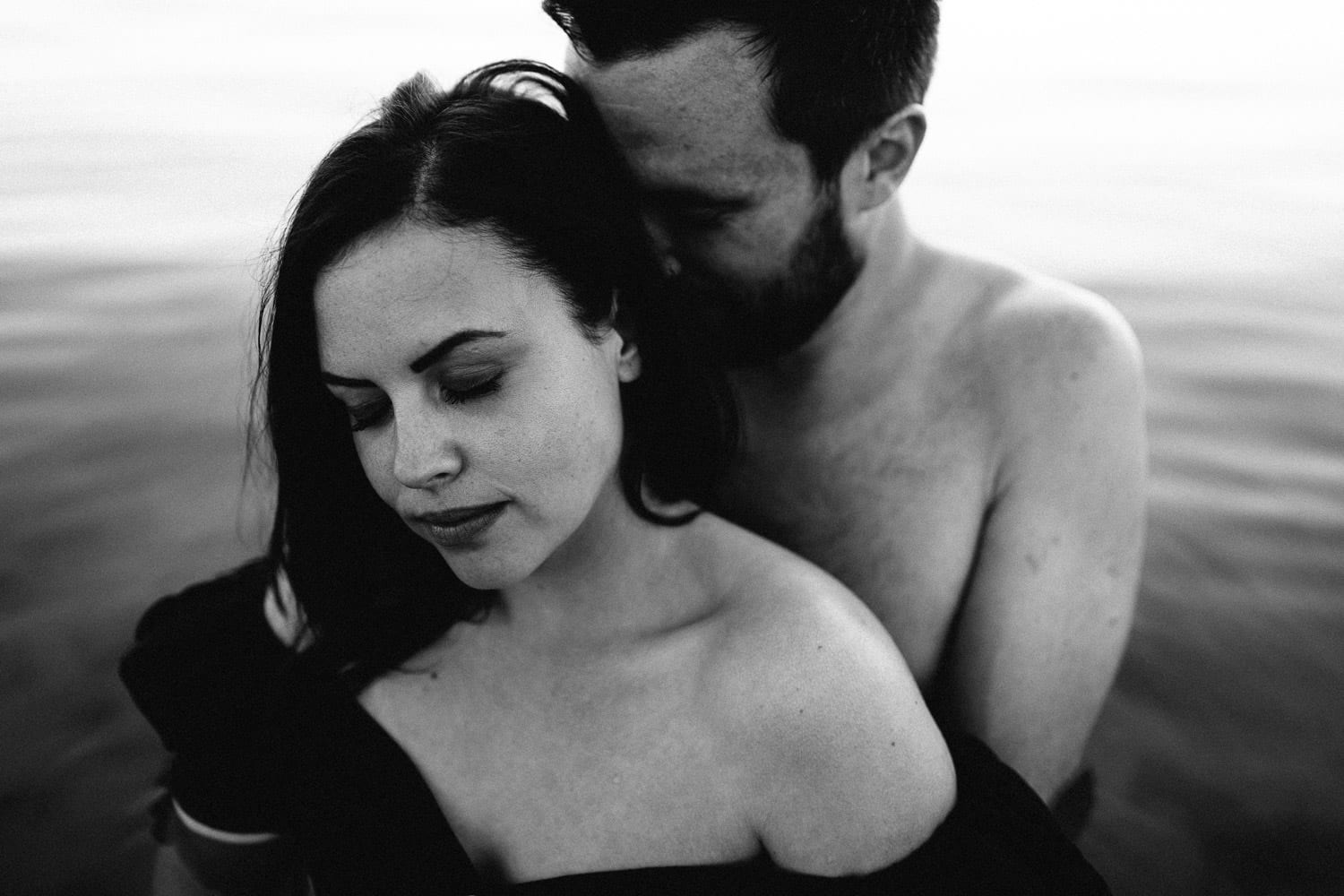 black and white of couple holding each other Engagement Photos Ireland