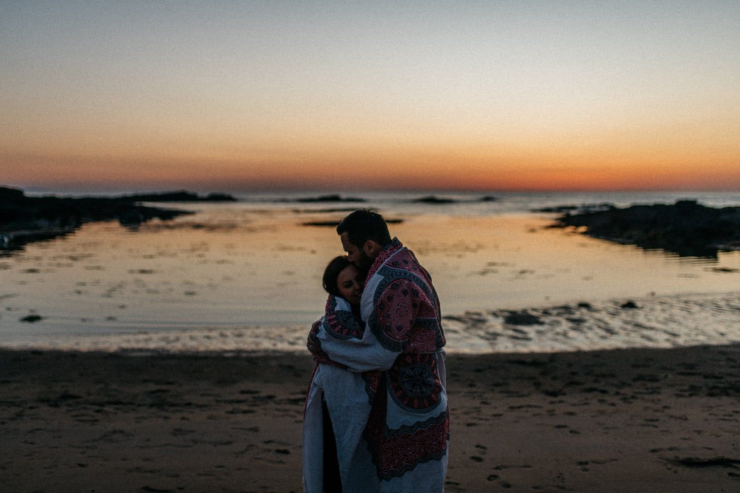 couple hugging at sunset Engagement Photos Northern Ireland