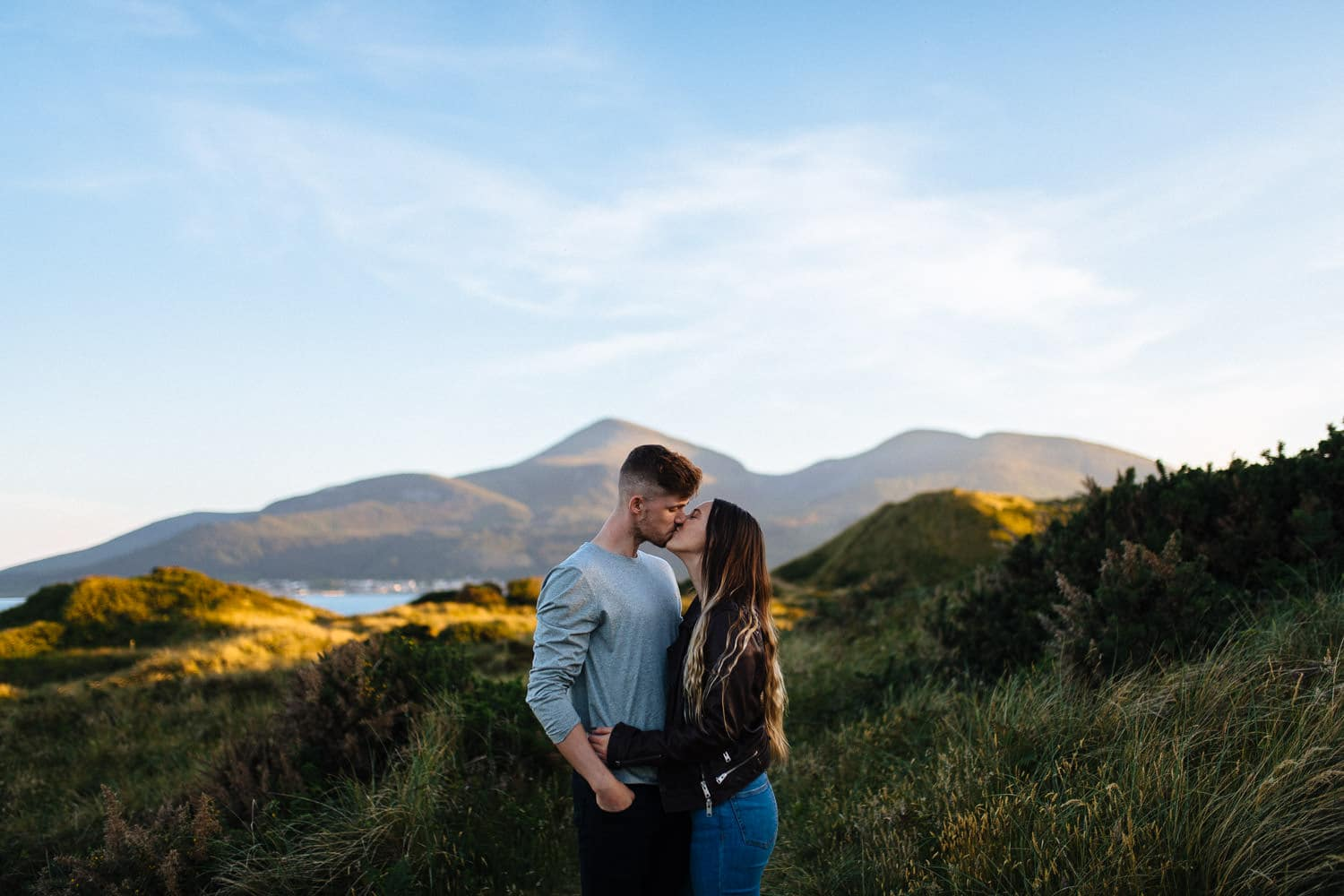 couple kissing in front of a mountain Belfast Engagement Photography