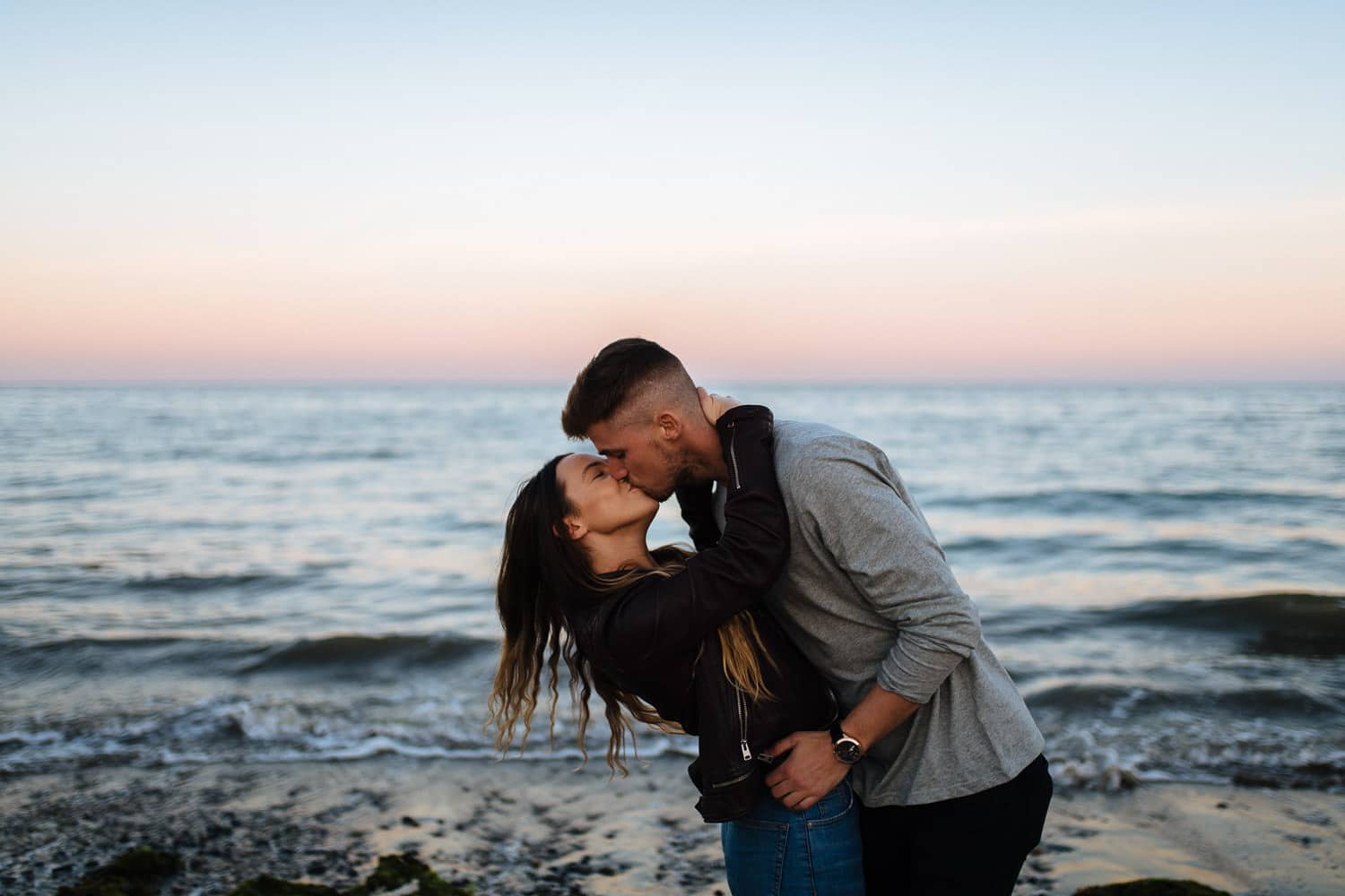 dipping kiss in front of the sea Belfast Engagement Photography