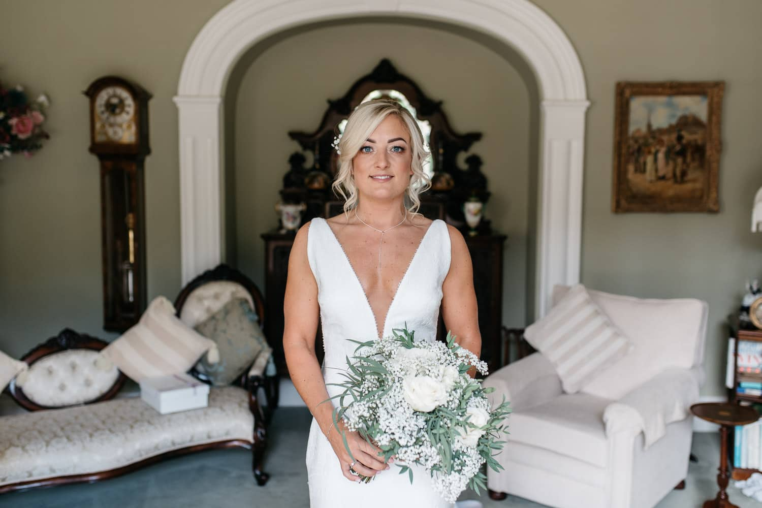 bride holding flowers in family home Wedding Photographer Northern Ireland