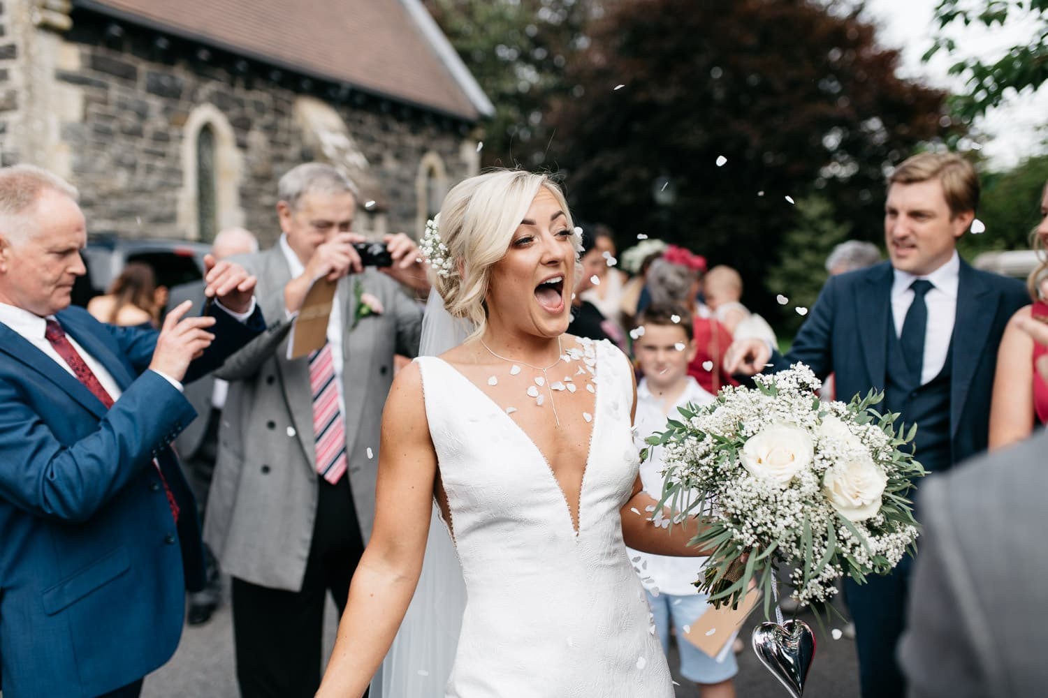 bride with confetti round her outside church Wedding Photos Northern Ireland