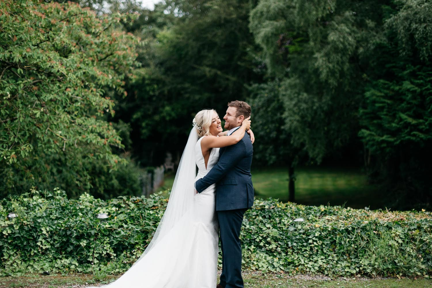 bride and groom laughing in garden Wedding Photographer Northern Ireland