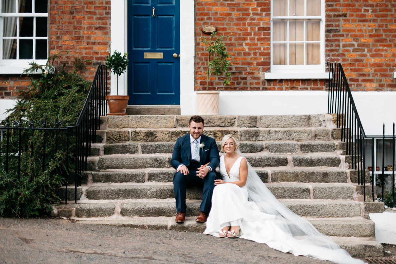 bride and groom sitting on steps Hillsborough Northern Ireland Wedding Photographer