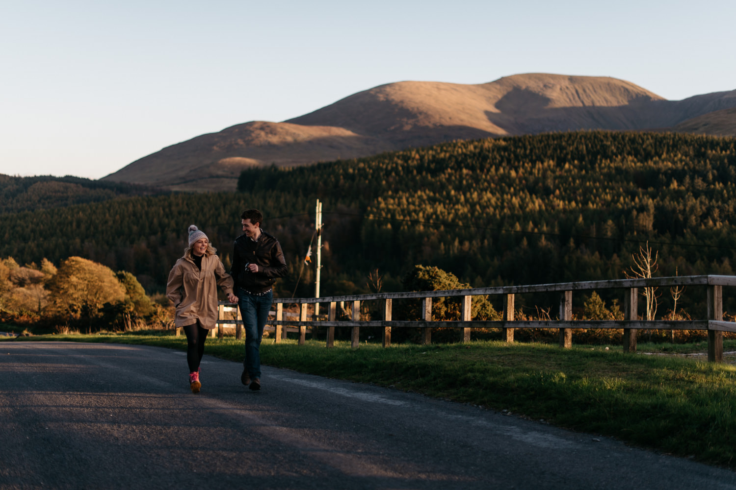 couple running holding hands Mourne Mountains Engagement Photography