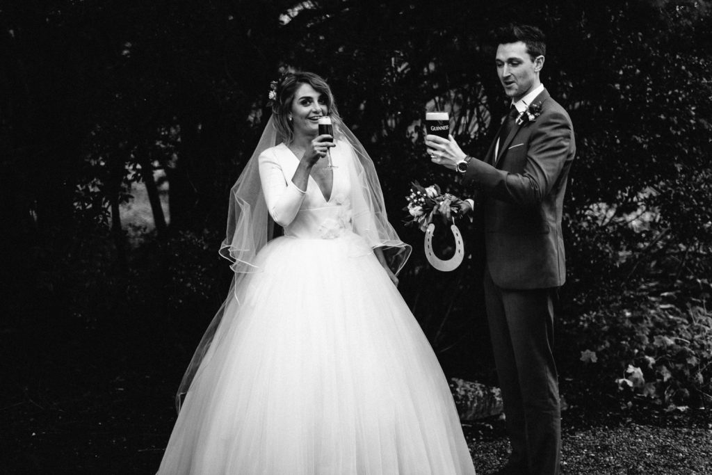 bride and groom having a pint wedding photography Larchfield Estate