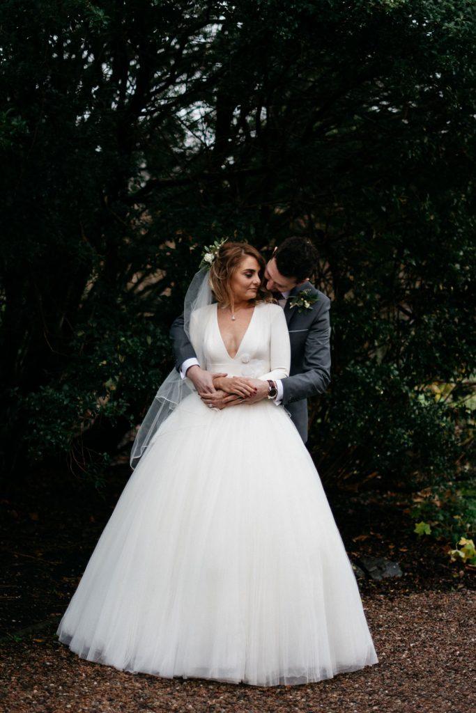 groom hugging bride Larchfield Estate Wedding