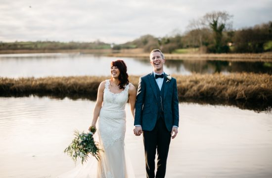 bride and groom laughing at the lake The Mill At Ballydugan Wedding Photography