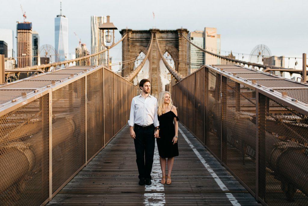 couple holing hands on Brooklyn bridgeNew York Engagement