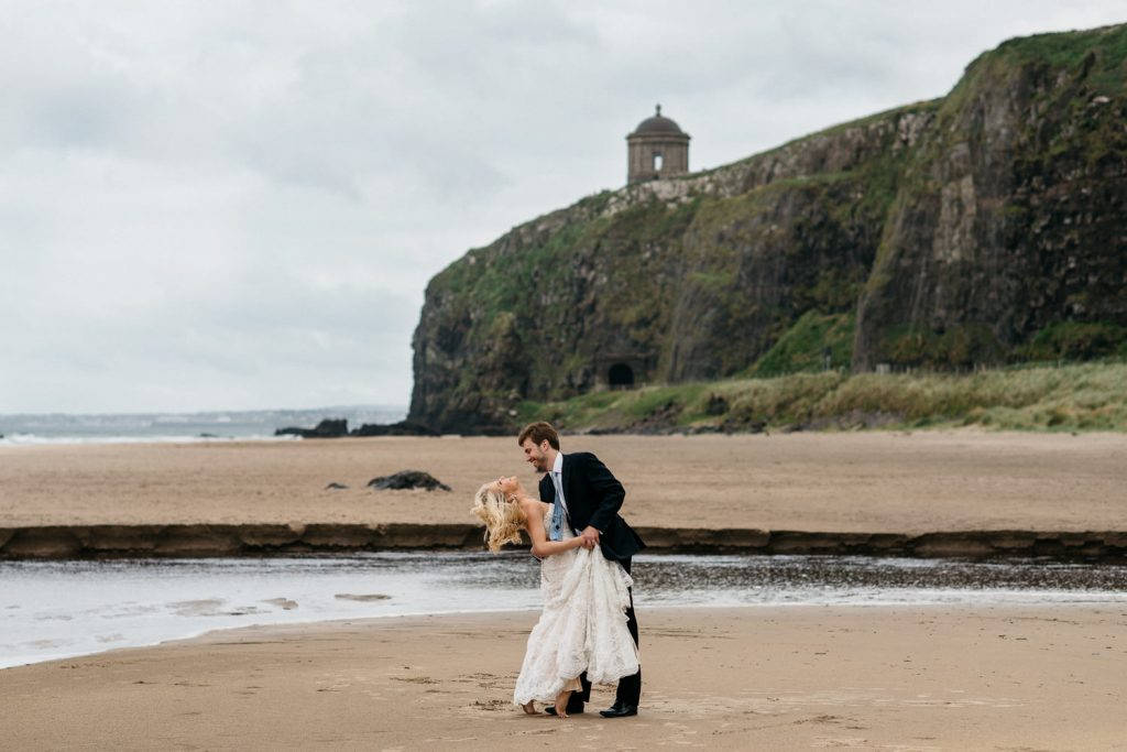 bride and groom dancing on downhill beach Mussenden Temple Wedding Photography