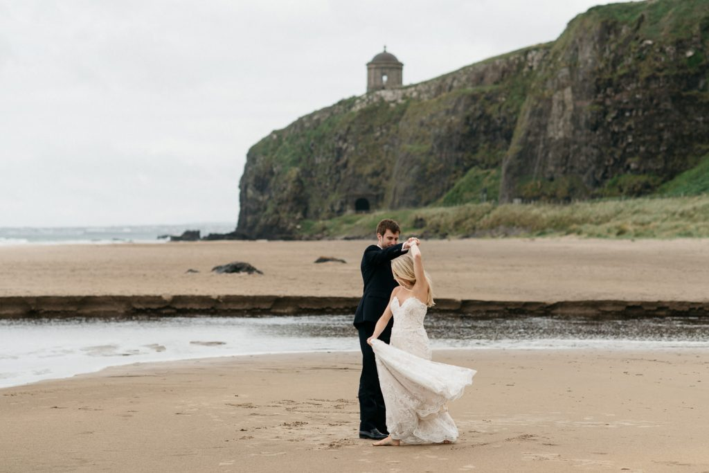 bride and groom dancing on downhill beach Mussenden Temple Wedding
