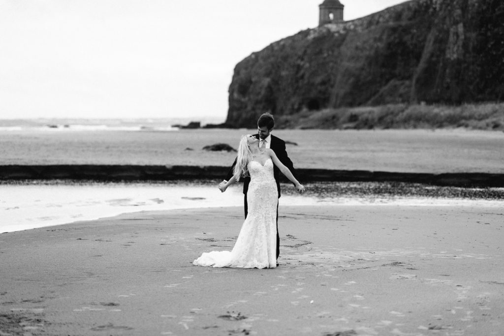 bride and groom dancing on downhill beach Mussenden Temple Wedding Photos