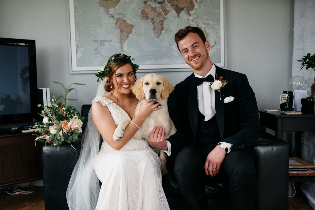bride and groom posing with dog for their wedding photos Northern Ireland Wedding Photographers