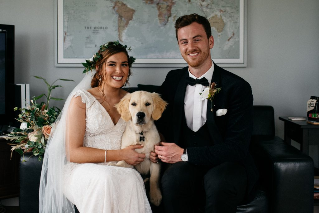bride, groom and dog posing for wedding portraits dding photos Northern Ireland Wedding Photographers