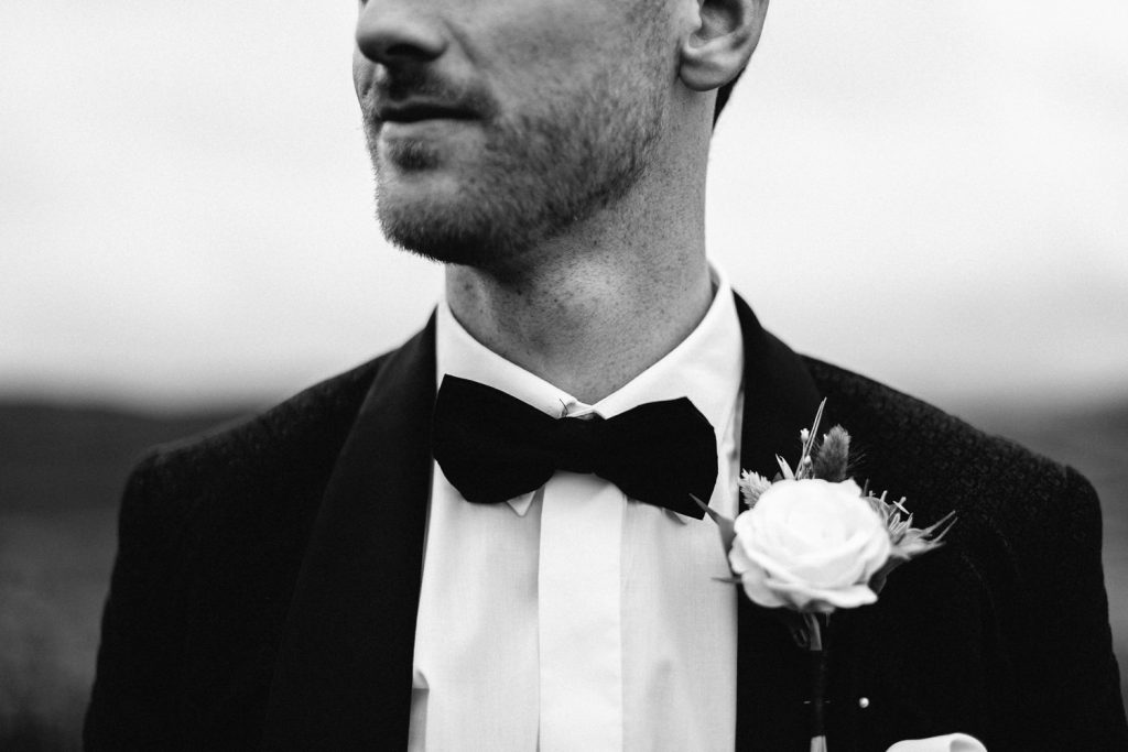 black and white picture of groom half his face cut off wedding photography Northern Ireland