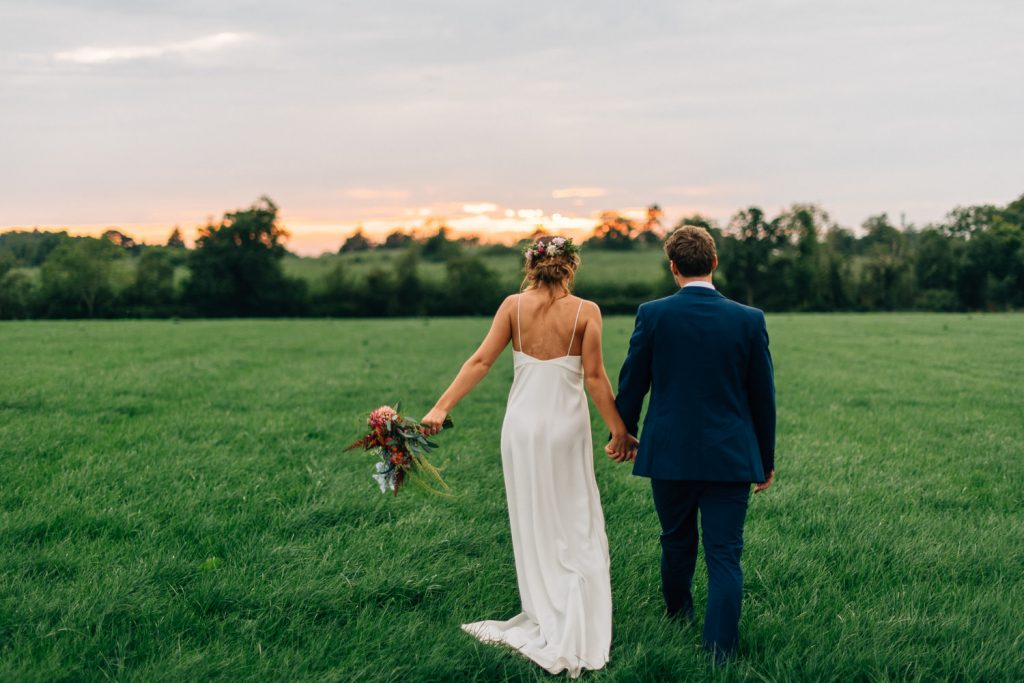 bride and groom walking into the sunset Gracehall Wedding Photography