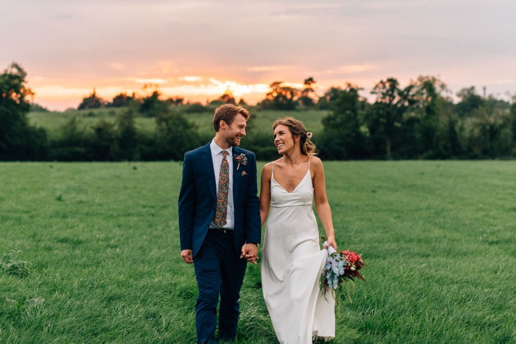 bride and groom laughing at sunset Gracehall Wedding Photography