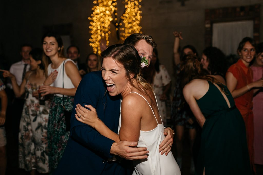 bride and groom first dance bride laughing Gracehall Wedding Photography