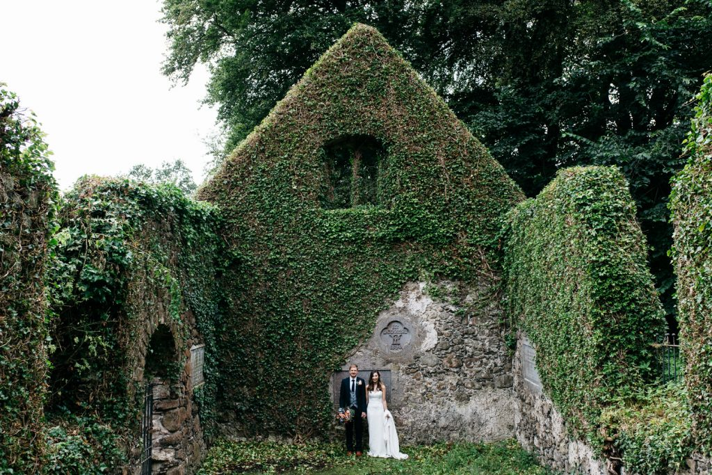 bride and groom holding hands in chapel ruins Ivory Pavilion Wedding photography