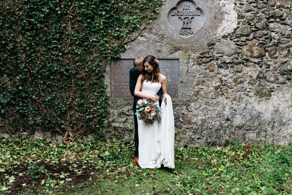 bride and groom hugging in chapel ruins Ivory Pavilion Wedding photos