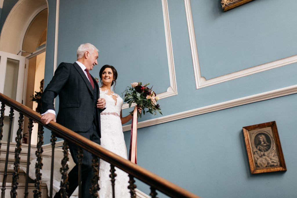 after walking bride down the stairs bride and groom dancing in the moon garden Drenagh House Estate Wedding
