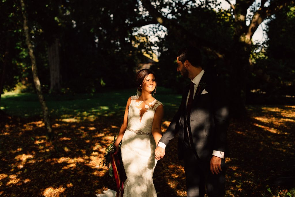 groom walking with bride in sunshine Drenagh House Estate Wedding