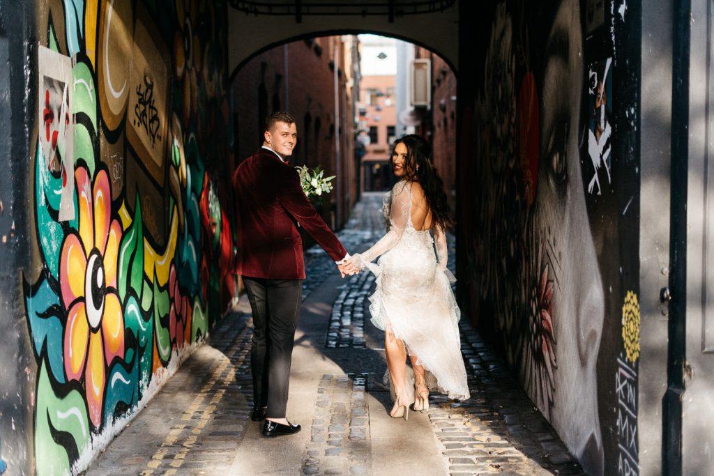 bride and groom walking down alley Merchant Hotel Belfast Wedding