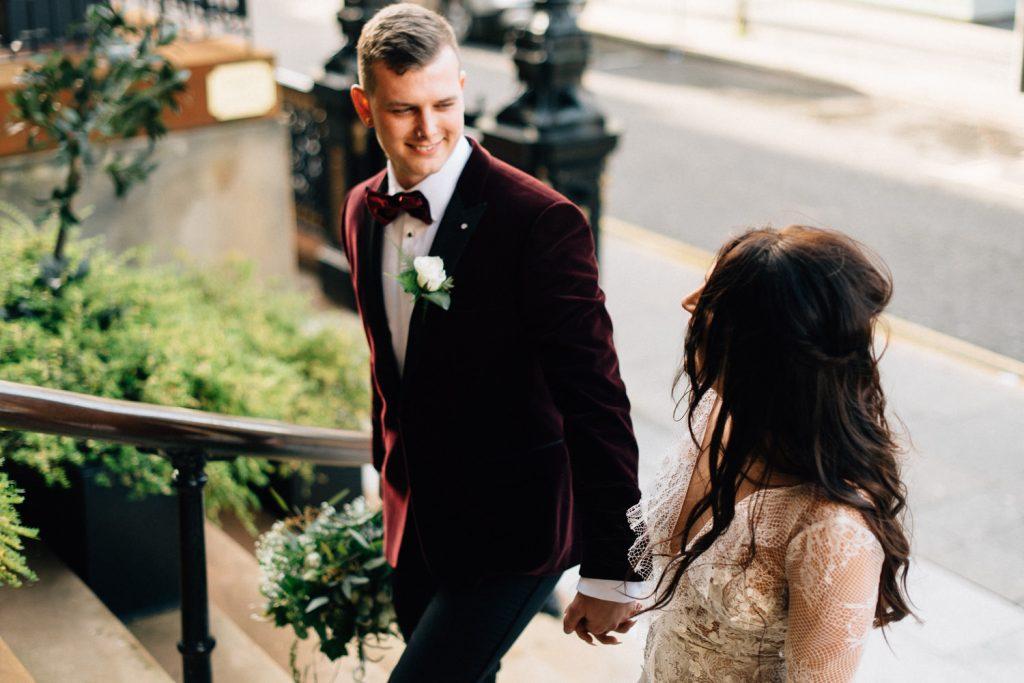 bride and groom walking up steps Merchant Hotel Belfast Wedding  Photographers