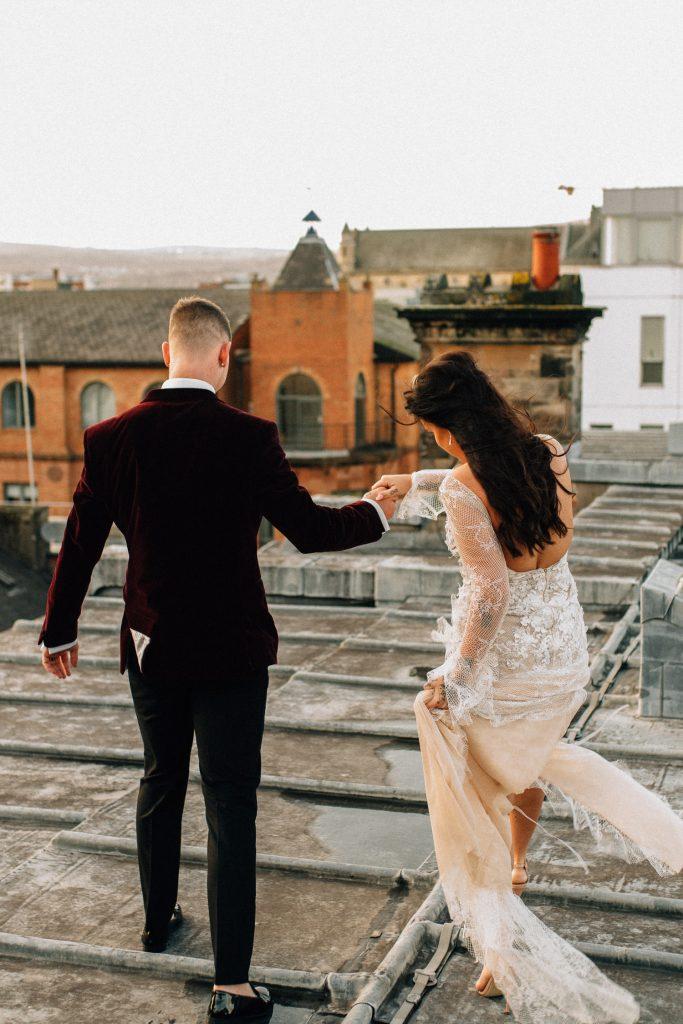 bride and groom walking on rooftop Merchant Hotel Belfast Wedding