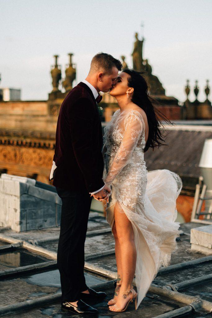 bride and groom kissing on roof top Merchant Hotel Belfast Wedding
