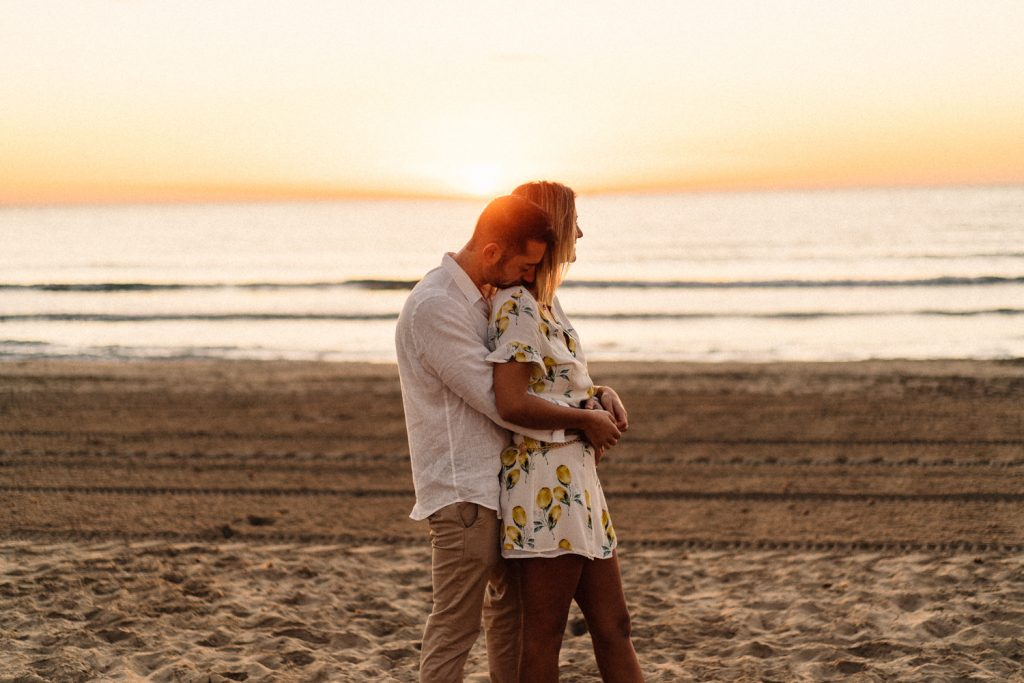 couple hugging at the beach side on sunrise Wedding Photographer Barcelona