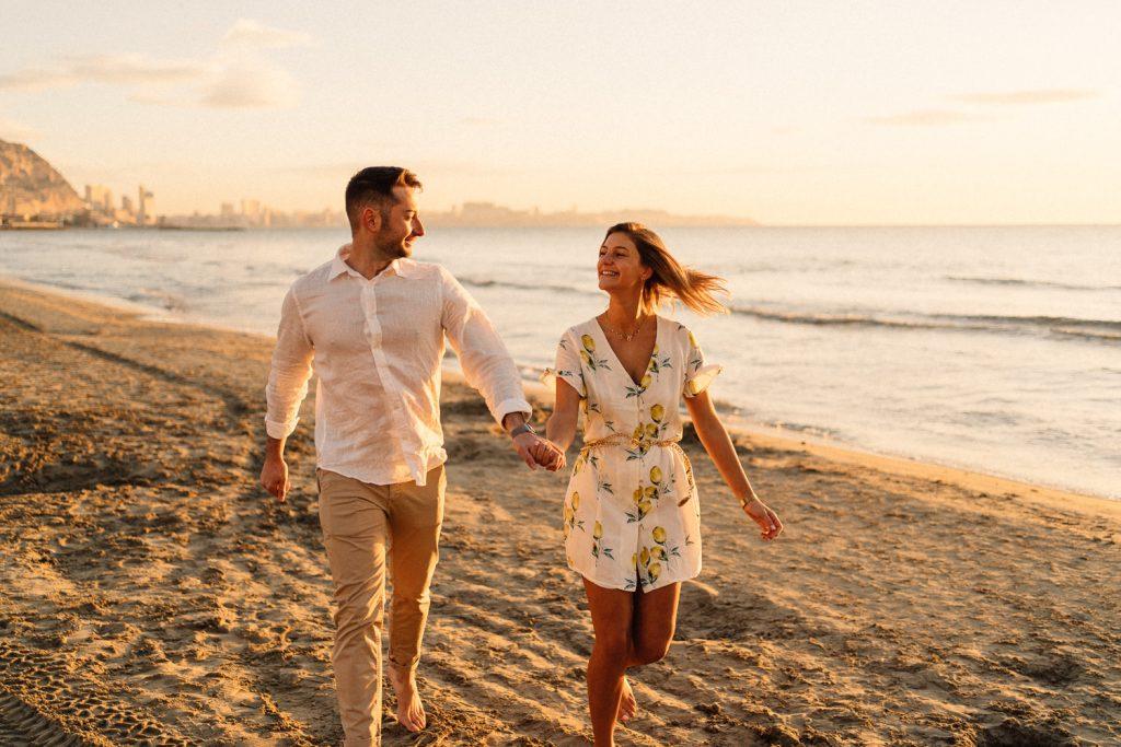 couple running on the beach Wedding Photographers Barcelona