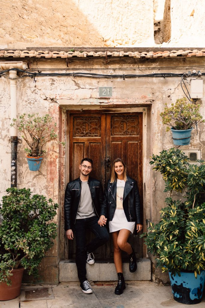 couple standing in front off old Spanish building Wedding Photography Barcelona