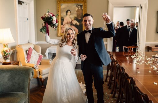 bride and groom cheering with drinks after being married Cultra Manor Wedding Photography