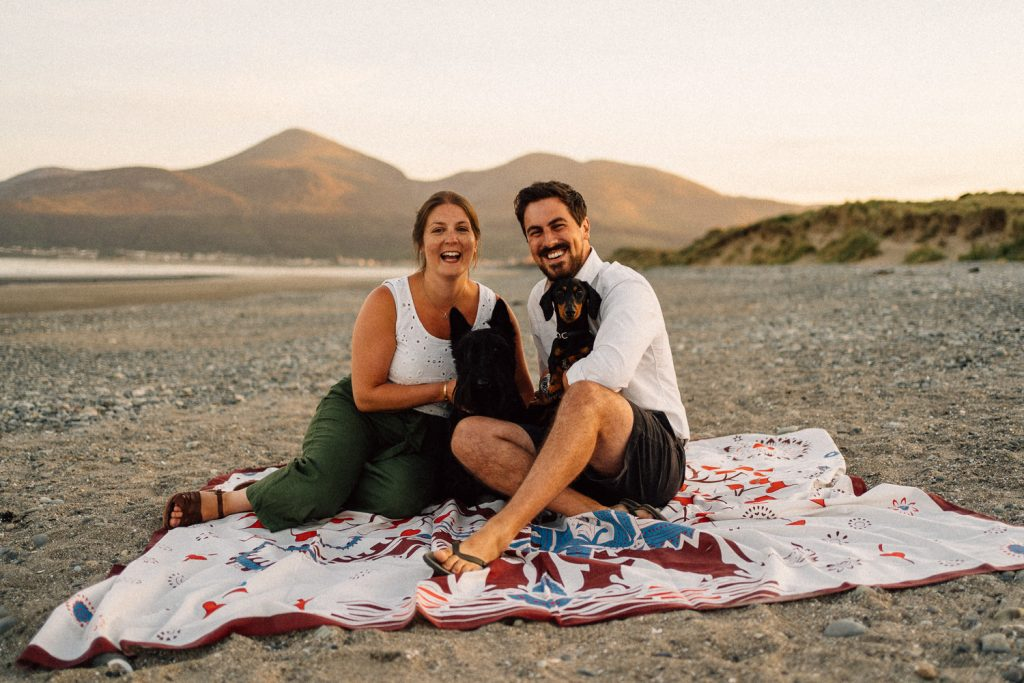 couple getting posing with their dogs Mourne Mountains in the background Engagement Photos Belfast