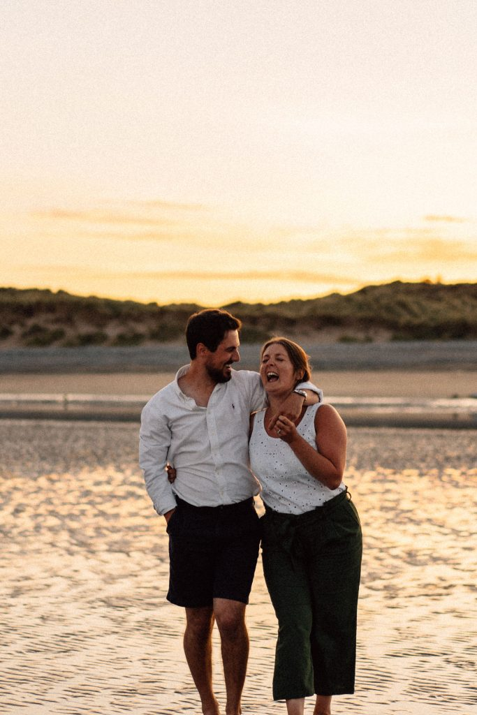Couple laughing at sunset Engagement Photos Belfast