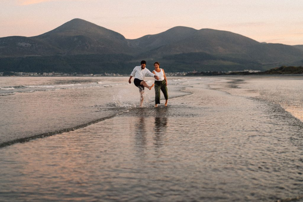 couple playing in the water Engagement Photos Belfast