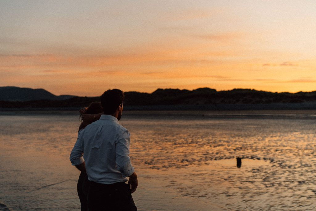 couple walking off into the sunset Engagement Photos Belfast