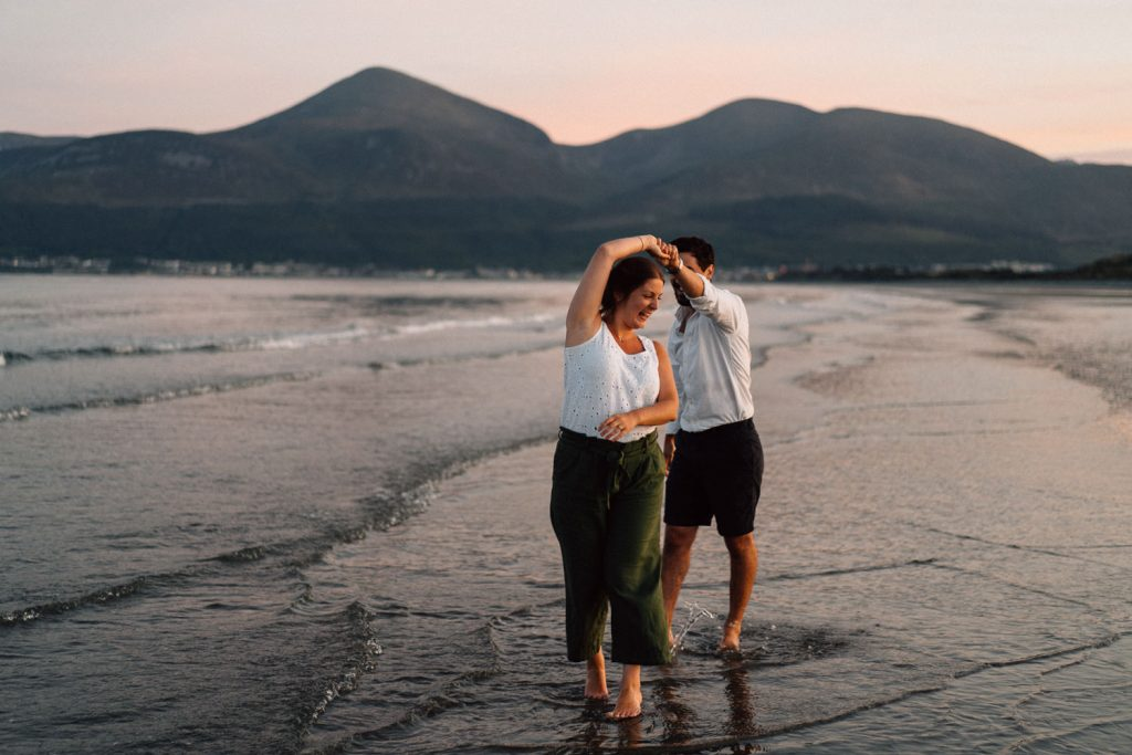 couple dancing in the sea Engagement Photography Belfast