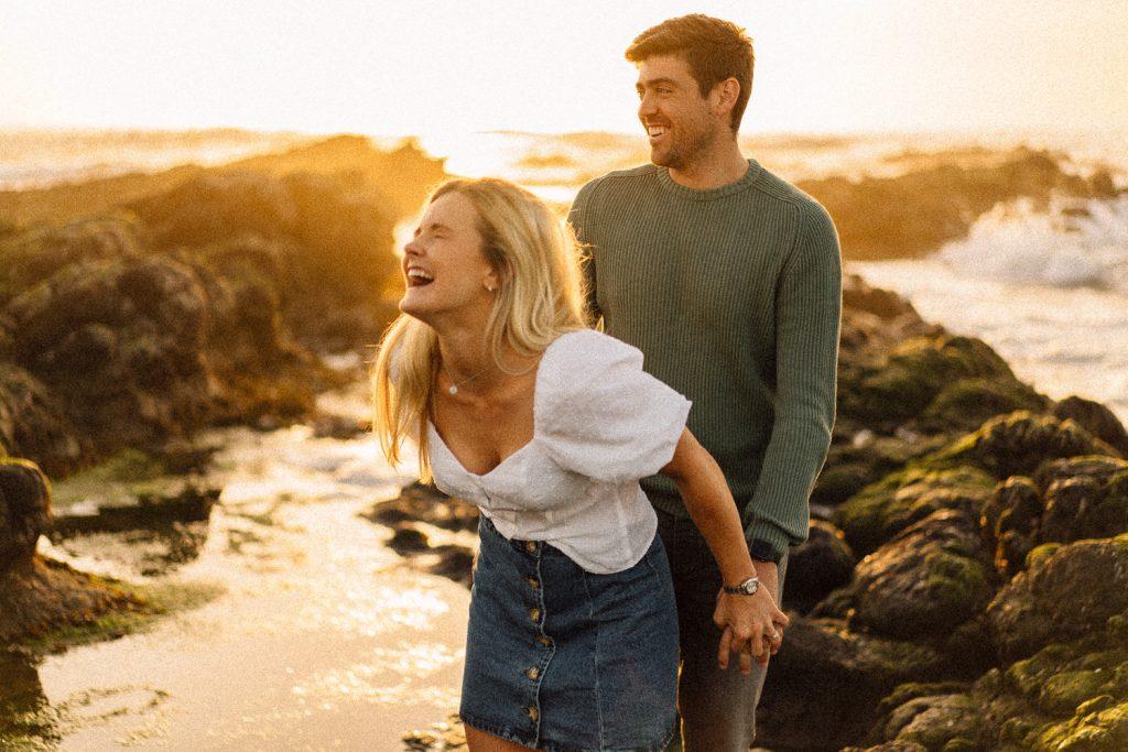 girl laughing at sunset on engagement shoot Northern Ireland Wedding & Engagement Photographer