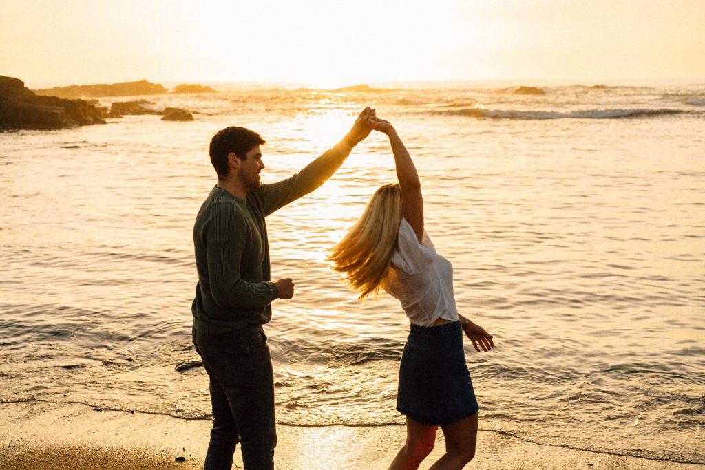 couple twirling at sunset Northern Ireland Wedding & Engagement Photographer