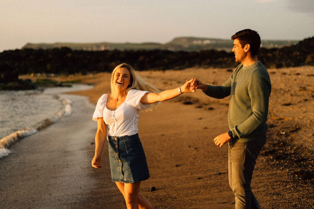 couple dancing on the beach at sunset Northern Ireland Wedding & Engagement Photographer