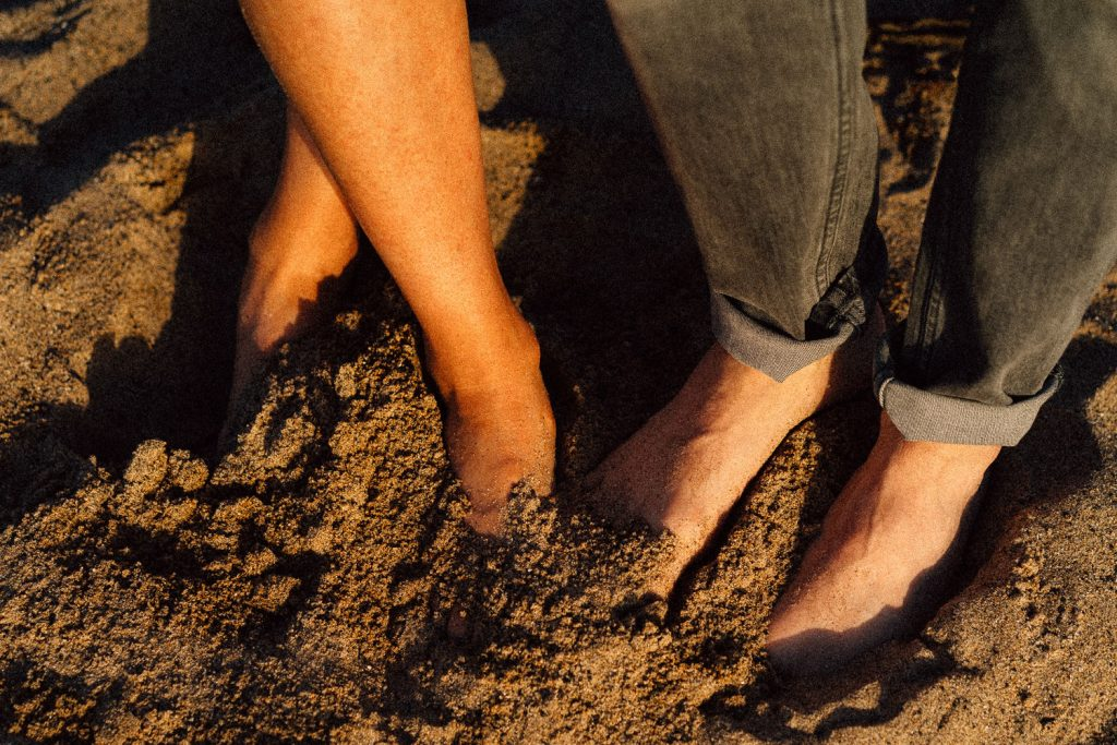 close up of couples feet in the sand Northern Ireland Wedding & Engagement Photographer