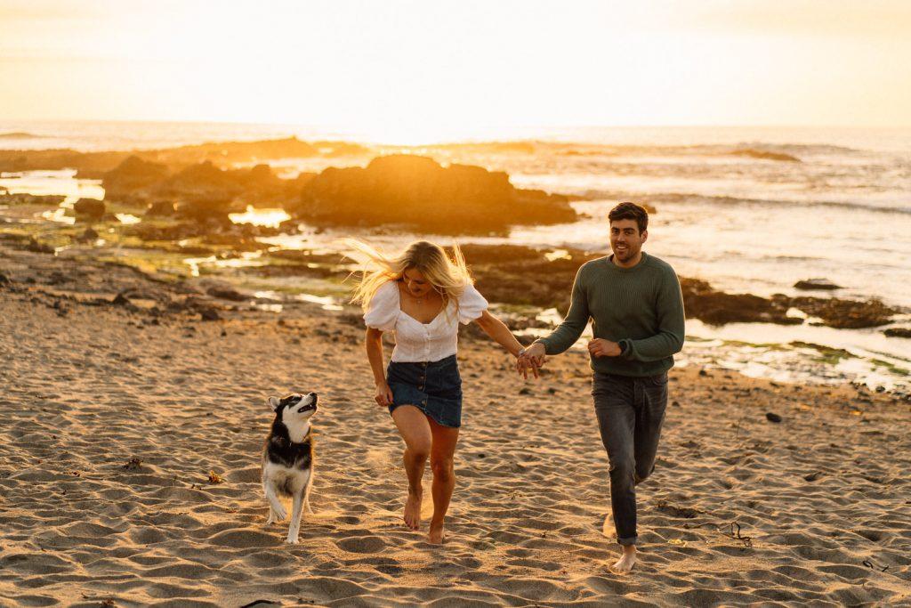 couple running with husky dog Northern Ireland Wedding & Engagement Photographer