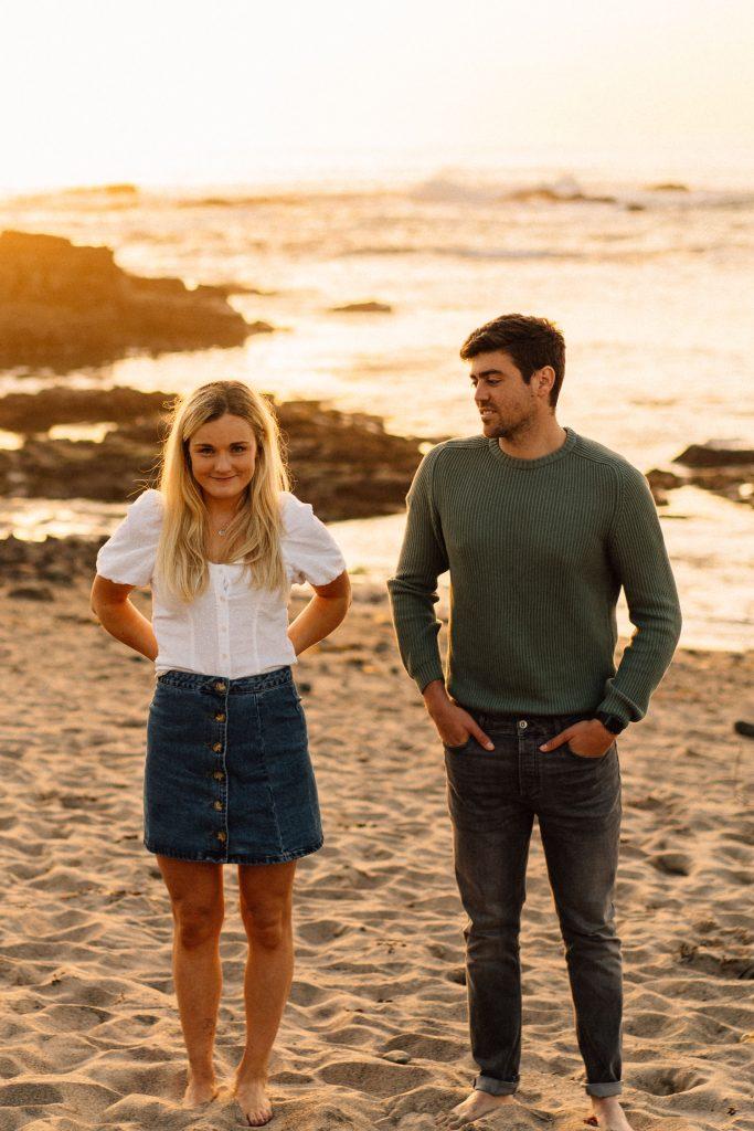 couple posing on the beach for photo Northern Ireland Wedding & Engagement Photographer